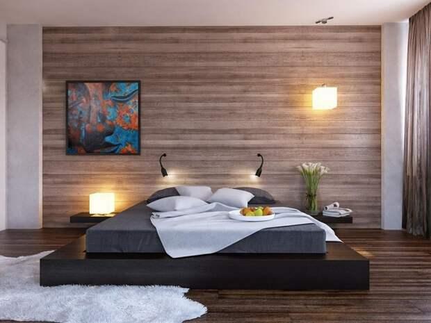 Спальня, которая оформлена в современном стиле с крутой кроватью на платформе.