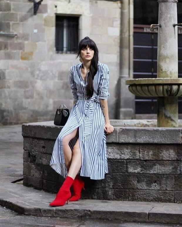 Красные сапожки станут изюминкой вашего образа. / Фото: whowhatwear.co.uk