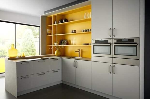 Оригинальное сочетание яркого желтого и нейтрального серого — актуальное решение для современной кухни. /Фото: kuhni-vminske.by