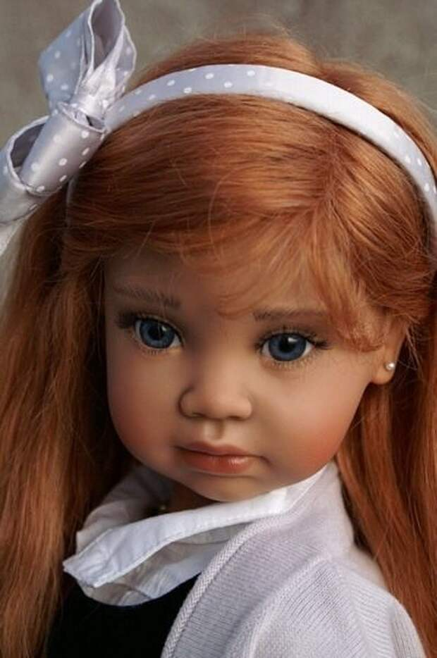 Надо же, как живые! Таких кукол ручной работы я еще не видела.