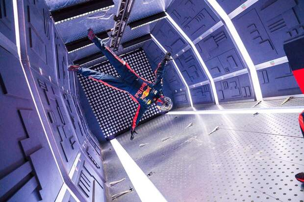 An Aston Martin Red Bull Racing mechanic pictured floating during the team's Zero-G pitstop aboard an aircraft in Russia.