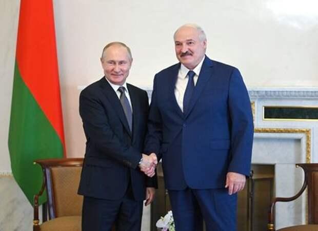 Russian President Vladimir Putin shakes hands with Belarusian President Alexander Lukashenko during a meeting in Saint Petersburg, Russia July 13, 2021. Sputnik/Alexei Nikolskyi/Kremlin via REUTERS