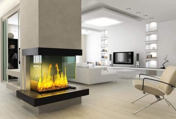 Электрический камин в интерьере просторной гостиной комнаты придаст помещению роскоши и шика.