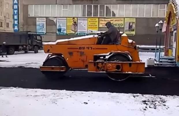 Зима работе не помеха — асфальт уже кладут на снег!