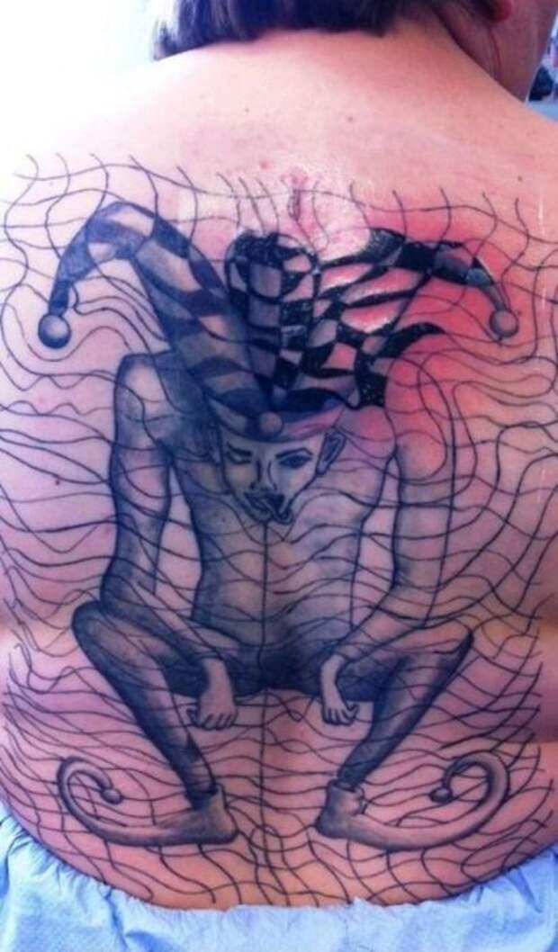 Странные татуировки и бодиарт (57 фото)