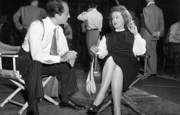 John Abbott and Bette Davis on the set of Deception directed by Irving Rapper, 1946.jpeg