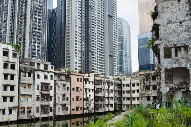 6 контрастных фото трущоб в центре Гуанчжоу, которые соседствуют с небоскрёбами