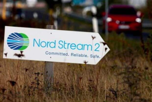 FILE PHOTO: A road sign directs traffic towards the Nord Stream 2 gas line landfall facility entrance in Lubmin, Germany, September 10, 2020. REUTERS/Hannibal Hanschke