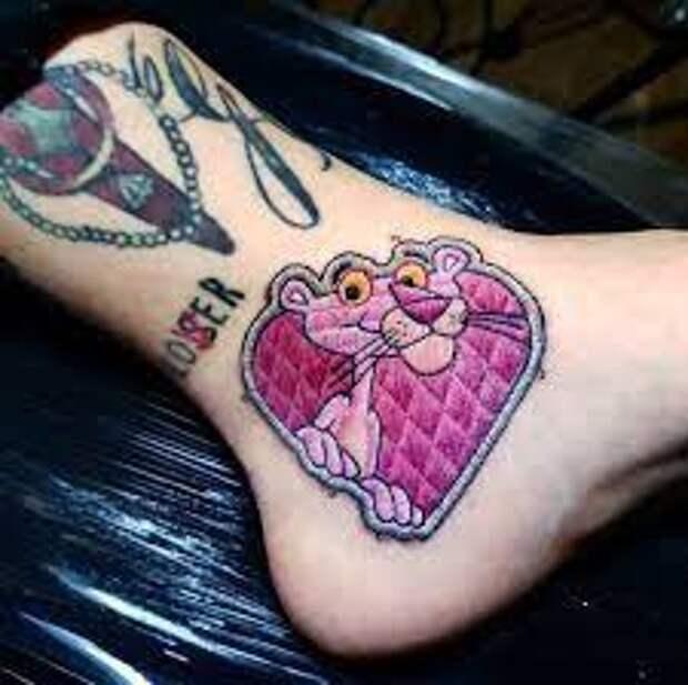 татуировка в виде вышивки гладью