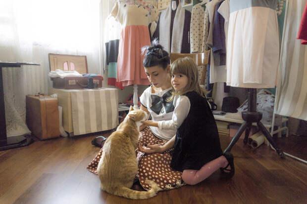 Фотографии кошек, которые живут в местах, где работают люди 6