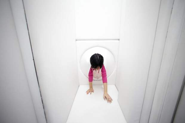 """An employee experiences """"birth"""" through a latex """"womb"""" at a Wake and Death Experience Pavilion in Shanghai"""