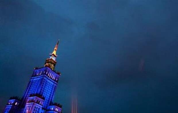The Palace of Culture and Science (PKiN) is illuminated in the evening in central Warsaw August 8, 2011. Poland and Ukraine are preparing to co-host the Euro 2012. REUTERS/Kacper Pempel (POLAND - Tags: SPORT SOCCER CITYSCAPE IMAGES OF THE DAY)