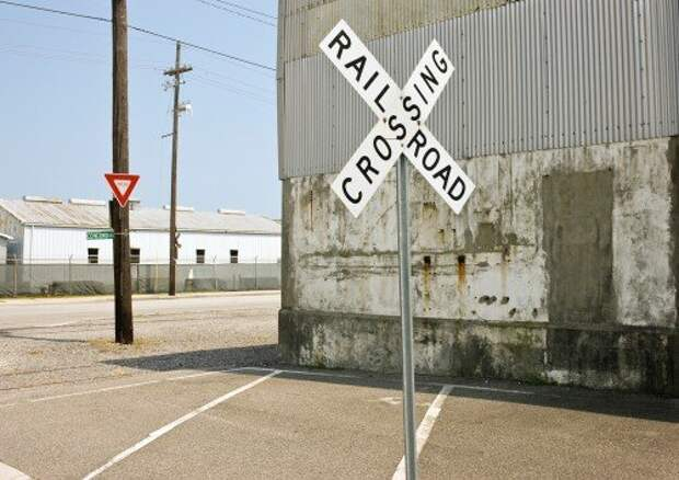 Railroad crossing sign in small town