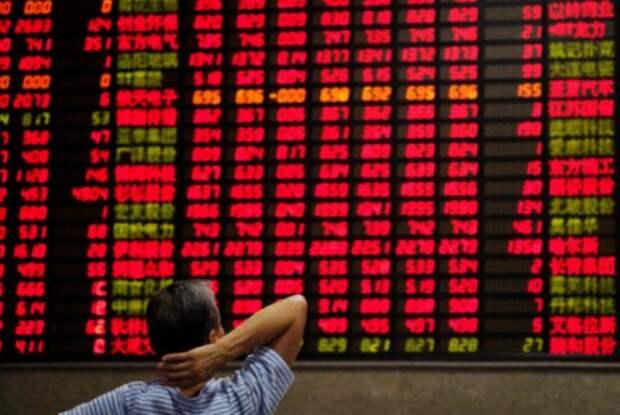 Электронная доска с котировками акций в брокерской конторе в Шанхае, Китай 7 сентября 2018 г. REUTERS/Aly Song