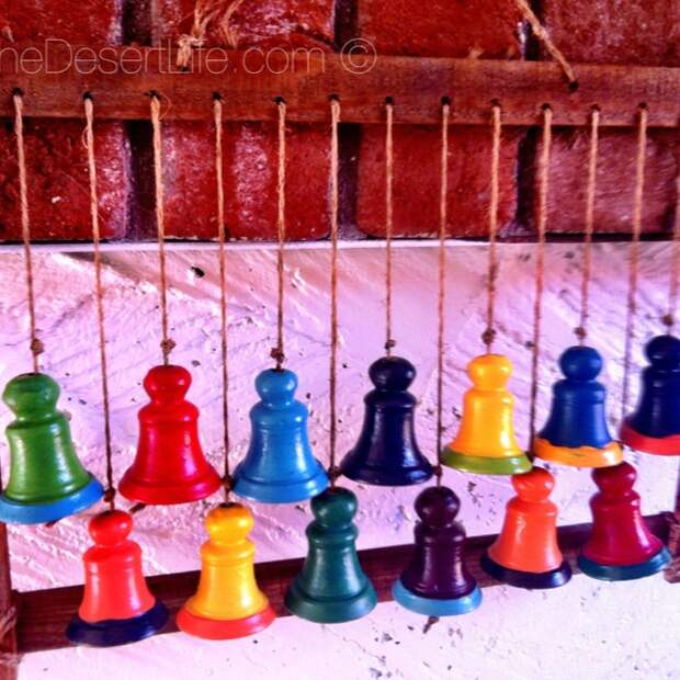 Painted these terra cotta bells in bright hacienda colors!