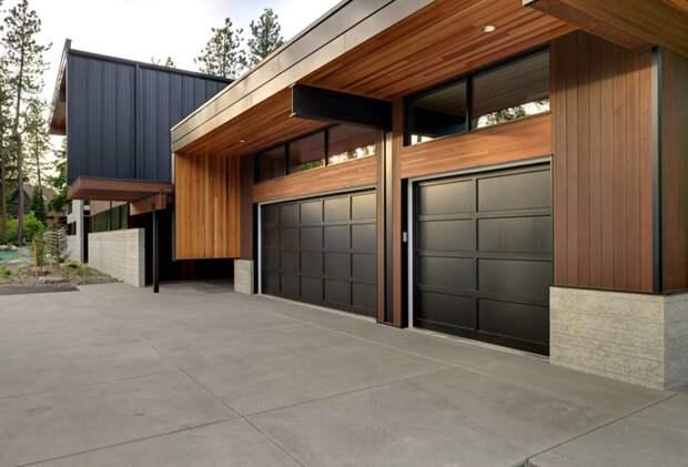 Где разместить гараж и другие хозяйственные постройки на участке?