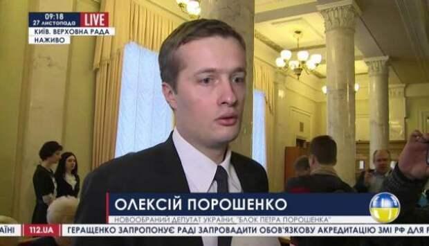 «Давайте его выкинем в мусорный бак!»: демонстранты погнались за сыном Порошенко - и догнали 18+