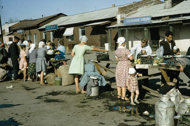 Russia, people at outdoor market. Siberia - Market for privately grown produce in a collective farm village