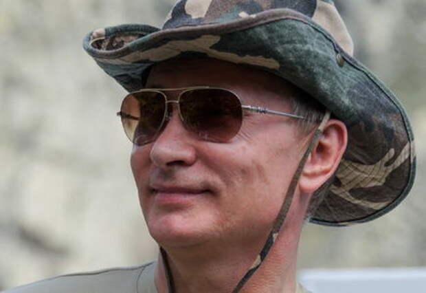 Путин в отпуске гонялся за щукой и ездил на квадроцикле