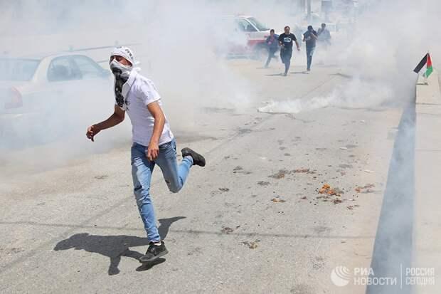 Участники протеста в Палестине против переноса посольства США в Иерусалим. 14 мая 2018