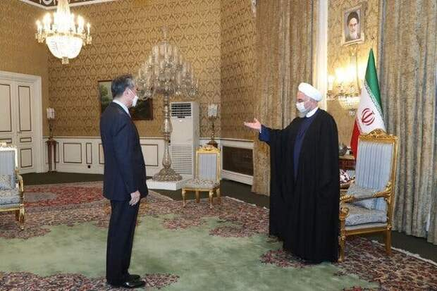 A photo released by Iran's presidential office showing Mr. Wang with President Hassan Rouhani in Tehran on Saturday.