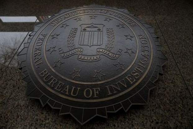 The FBI seal and motto are seen at of the J. Edgar Hoover Federal Bureau of Investigation (FBI) Building in Washington, U.S., February 1, 2018. U.S. President Donald Trump is expected to announce soon that he will release a controversial memo that purports to show bias against him at the FBI and Justice Department as they investigated contacts between Trump's presidential campaign and Russia. REUTERS/Jim Bourg