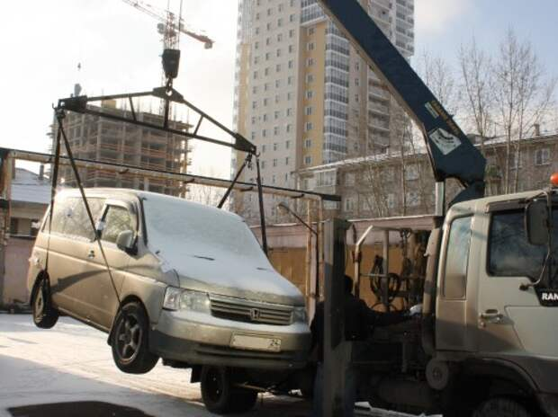 Житель Красноярска лишился авто за долги ЖКХ