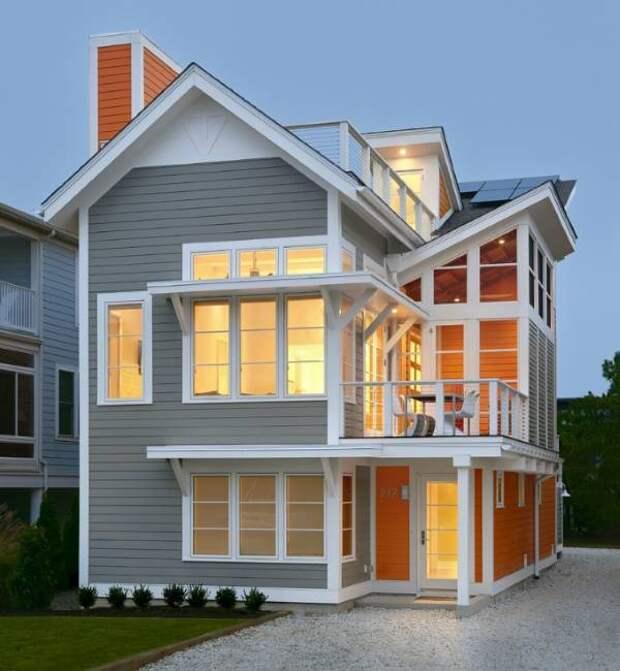 Современный фасад частного дома в сером и оранжевом цвете