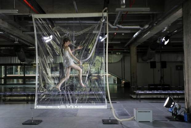 A model is seen in a vacuum pack before the Iris van Herpen Fall/Winter 2014-2015 women's ready-to-wear collection show during Paris Fashion Week on March 4, 2014. (Photo by Stephane Mahe/Reuters)