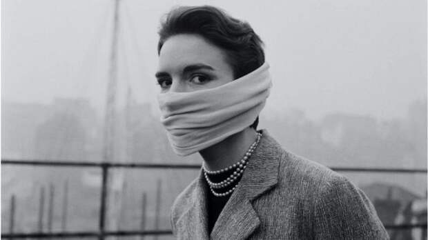 woman wearing smog mask in 1953