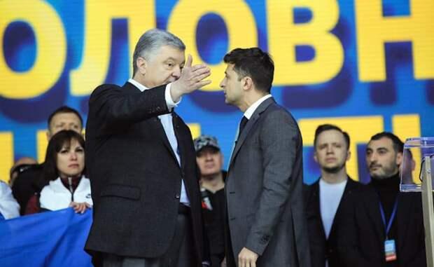 Киев, СК «Олимпийский»: Порошенко бросился на Зеленского и получил удар в челюсть