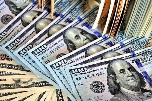 Банкир рассказал, будет ли доллар по 65 рублей